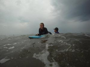 Me riding a wave with an instructor from long line surf school behind me.